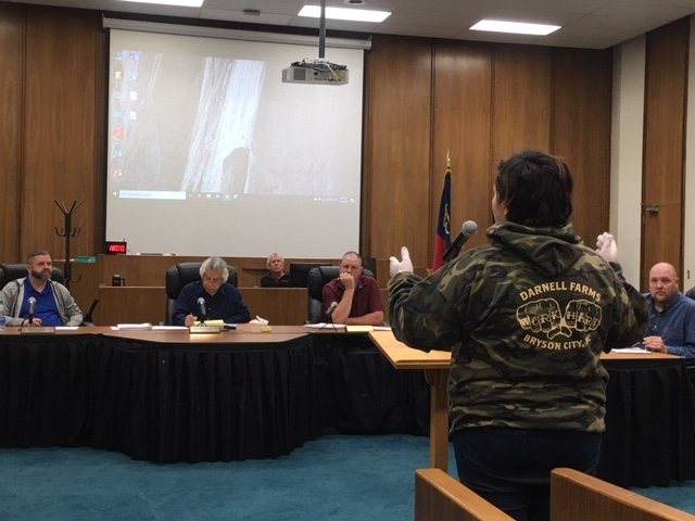 Afton Roberts with Darnell Farms speaks to the Swain County Board of Commissioners at the special called meeting Monday, where the board issued an order to close hotels and other vacation stays until further notice.