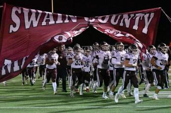 The Swain County Maroon Devils varsity football team takes the field against Hayesville.