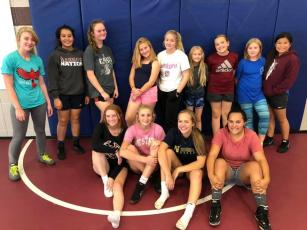 The new Swain High Lady Devils Wrestling team is pictured after their first official practice on Oct. 30. Some have competed on co-ed teams in the past and for others, the sport is new.