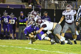 The 2019 Maroon Devils Varsity Football team had a good run this season, wrapping things up with a loss to 2nd seed Mitchell in the third round of playoffs. Above, Maroon Devils defense takes down a Mountaineer in the game that ended in a score of 38-6.