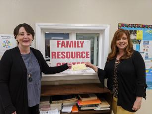 Karen Proctor of the Swain County Chamber of Commerce presents Family Resource Center Director Melissa Barker with a check for $150 for food purchases.