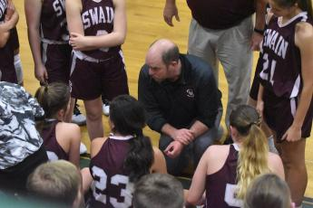 Coach Michael Turner talks to his athletes of the Swain County High School girls basketball team