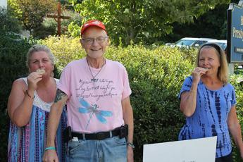 "Sam Brandt is called ""Sam, the cookie man"" at The Giving Spoon for the cookies he bakes and donates. From left is Janet Carter, Sam Brandt and Maureen Murphy."