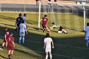 Photo by Chris Readman. Junior Lucas Trantham scores the final goal on the Hayesville Goalkeeper.