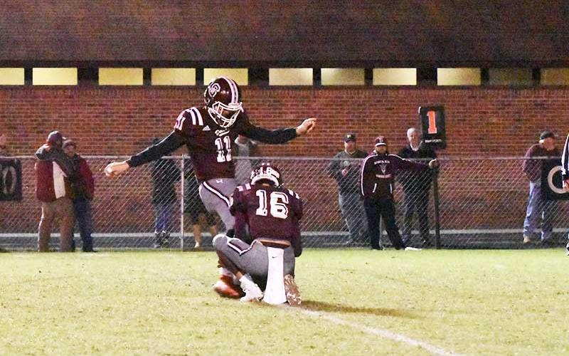 Photo by Joanna McMahan - Maroon Devil kicker and holder get ready to send the ball down the field.