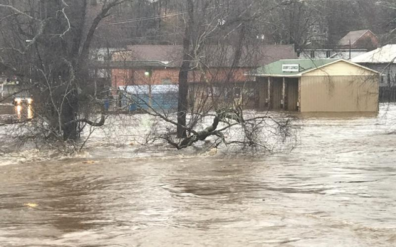 The Tuckasegee River overflowed its banks on Thursday following 3-4 inches of rain. Pictured above, the river reaches beyond Island Street and up by Grumpy's Car Wash in downtown Bryson City.