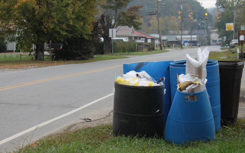 trash waiting for pickup outside a business on Bryson Walk