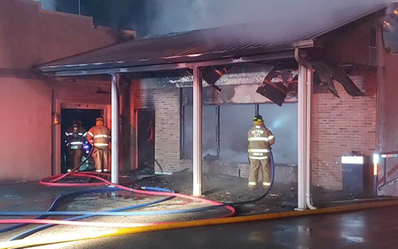 ocal firefighters fight a fire that started in the basement floor below the old service station section of a vacant funeral home on Main Street in the early hours of Saturday morning.